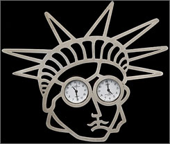 """The first female secretary of State put some of her trademark pins in a touring collection This silver """"Liberty"""" brooch by Gijs Bakker allows both Albright and her guest to tell time."""