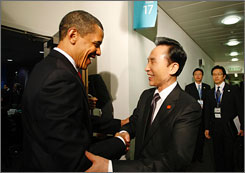 President Obama and South Korean President Lee Myung Bak, shown at the G-20 summit on Thursday, discussed the need for a united response if North Korea goes ahead with a rocket launch.