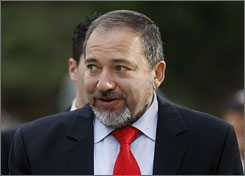 Israeli police have continued questioning Avigdor Lieberman, the country's new foreign minister, seen here during a change of power ceremony in Jerusalem on Wednesday.