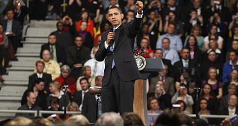 """Obama speaks during the town hall meeting on Friday. He said the United States shares blame for the crisis, but that """"every nation bears responsibility for what lies ahead  especially now."""""""