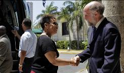 Rep. Barbara Lee, D-Calif, shakes hands with Jonathan Farrar, head of the U.S. Interests Section in Havana, Cuba, on Friday. Members of the Congressional Black Caucus traveled to Cuba on Friday in another sign of Congress' apparent interest in easing a long-standing trade embargo and travel restrictions.