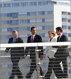 From left to right, NATO Secretary General General Jaap de Hoop Scheffer, President Obama, German Chancellor Angela Merkel and French President Nicolas Sarkozy walk on a bridge from Kehl, Germany into Strasbourg, France, on Saturday to get the NATO summit started this weekend.