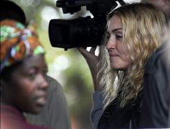 Madonna visits a development project in Malawi on Friday. In a surprise move, a judge rejected her request to adopt a second child from the African nation.