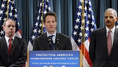 Federal Trade Commission Chairman Jon Leibowitz, left, Treasury Secretary Timothy Geithner, center, and Attorney General Eric Holder hold a news conference announcing their new multi-agency crackdown on mortgage loan modification fraud and foreclosure rescue scams on Monday at the Treasury Department in Washington.