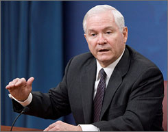 Defense Secretary Robert Gates, seen here during a Pentagon news briefing in March, has proposed a $534 billion budget that includes weapons cuts.