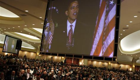 President Obama projected from video screens as he speaks at the National Prayer Breakfast in Washington in February. Obama used the platform to unveil a new-look White House Office on Faith-Based and Neighborhood Partnerships.