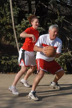 Mark Watts, 57, works up a sweat playing basketball with his daughter Hilary, 16, at their home in New Haven, Ind. He had surgery on his right knee four years ago to mend a 30-year-old anterior cruciate ligament (ACL) injury.