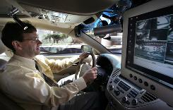 University of Iowa researcher Jeffery Dawson drives the Nissan-Iowa Instrumented Research Vehicle for Advanced Neuroergonomic (NIRVANA), in Iowa City, Iowa. NIRVANA is the newer version of the Automobile for Research in Ergonomics and Safety (ARGOS) vehicle used to predict safe and unsafe driving abilities in elderly drivers, including those with Alzheimer's.