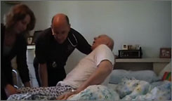 This image from video released by John Demjanjuk's family shows Demjanjuk getting assistance getting out of bed in Seven Hills, Ohio, on Thursday.