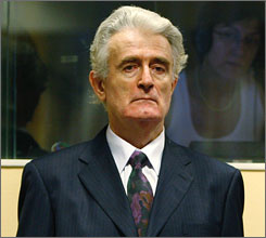 International judges have rejected an appeal for immunity for genocide charges against former Bosnian Serb leader Radovan Karadzic, seen here standing before the International Criminal Tribunal at The Hague, Netherlands, last July.