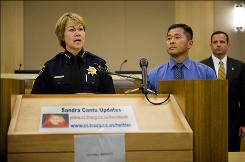 Tracy Police Chief Janet Thiessen, left, FBI Agent Todd Irinaga and Sgt. Tony Sheneman, right, conduct a news conference in Tracy, Calif., Monday. Authorities found the remains of Sandra Cantu, a missing 8-year-old Northern California girl, on Monday in a suitcase a few miles from where she was last seen.