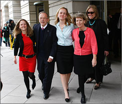 Former senator Ted Stevens, R-Alaska, leaves federal court in Washington on Tuesday after a judge dismissed his corruption conviction. Here, Stevens is seen with, left to right, daughters Beth, Lilly and Susan Covich, and wife, Catherine.