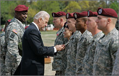 Vice President Biden awards the Bronze Star to Maj. Lisa Garcia on Wednesday during a welcome home ceremony at Fort Bragg, N.C.