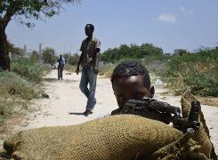 A hard-line Islamist Somali is poised at a checkpoint in Mogadishu last month. The African Union has about 3,000 peacekeepers in the capital, but violence is rife.