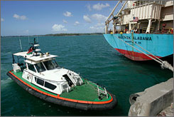 A Kenyan police boat patrols near the Maersk Alabama at the port of Mombasa, Kenya, on Monday.