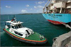 A Kenyan police boat patrols near the Maersk Alabama at the port of Mombasa, Kenya, on Monday.