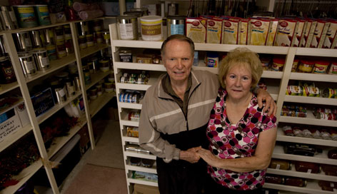 Frank and Patsy Jackson stand in their basement food storage room surrounded by cans and boxes they've stockpiled at their home in Leeds, Utah Feb. 10.