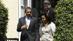 President Obama and the first lady leave St. John's Church after an Easter service.