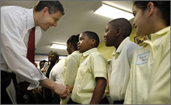 Secretary of Education Arne Duncan, left, greets students in Washington, D.C., before delivering tickets for the White House Easter Egg Roll.