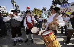 Activists wear Boston Tea Party-themed costumes during a tax revolt rally earlier this month in Santa Barbara, Calif.