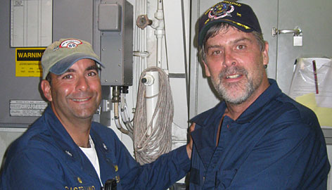 Capt. Richard Phillips, right, appears after his rescue with Cmdr. Frank Castellano on the USS Bainbridge.