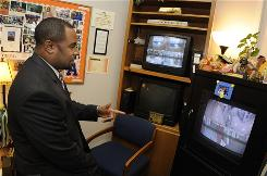 Principal Robert Johnson can monitor some 33 cameras from his office in Addison Middle School in Roanoke, Va.