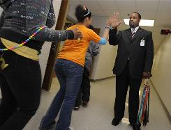 Principal Robert Johnson makes it a point to interact with his students each day at Addison Middle School in Roanoke, Va.