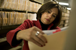 Terri Moore checks files at the Dallas DA's office.