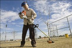 Debbie Primeau at work at the Desert West Park and Sports Complex. When Phoenix cut its workforce by 1,000 positions, Primeau was transferred instead of laid off.