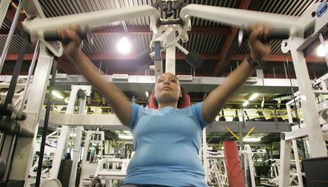 Ebony Lugo, 23, works out at Dolphin Gym in the Bronx. Lugo was able to lose 48 pounds by cooking at home and packing her lunch.