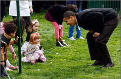 President Obama checks to see if everyone is ready at the start of the annual Easter Egg Roll on the South Lawn of the White House in Washington on Monday.