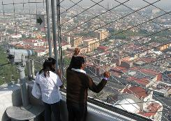 Visitors take in the view from the observation deck of the Latin American Tower in Mexico City on Tuesday. President Obama arrives in Mexico City on April 16.