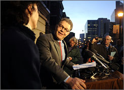 Democrat Al Franken grinned at his wife, Franni, on Monday outside his Minneapolis home after a court confirmed he's won the most votes in the Senate race against his Republican opponent, incumbent Norm Coleman.