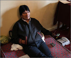 Bolivian President Evo Morales, seen here sitting during a hunger strike at the presidential palace in La Paz on Monday, has decided to end his hunger strike after lawmakers approved new regulations for general elections .