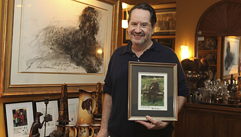 Barry Landau poses for a portrait with a photo of former president Bill Clinton and his dog Buddy and other items that are part of his memorabilia collection on Tuesday in New York.