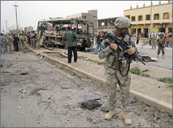 A U.S. Army soldier surveys the scene of a car bomb in Kirkuk, Iraq, on Wednesday that left 11 people dead.