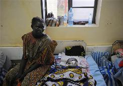 A Sudanese mother looks over her malaria-infected baby in the main hospital in Juba, April 2. The infectious parasitic disease is a leading cause of death of infants and children in Africa.