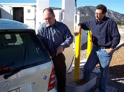 National Renewable Energy Lab's Kevin Harrison demonstrates hydrogen fueling to Frank Sesno, right, who's hosting a primetime PBS special a week before Earth Day about the nation's energy future.