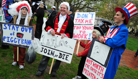 "A group dressed in patriotic costumes protest during a ""tea party"" demonstration in Lafayette Park across from the White House on April 15."