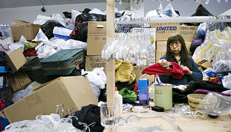 Pauline McFarland sorts clothing at the Salvation Army Family Store in Juneau, Alaska, on March 11.