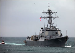 The USS Bainbridge arrives in the harbor of Mombasa, Kenya, on Thursday with Capt. Richard Phillips on board. Phillips was held captive in the Gulf of Aden by Somali pirates, who tried to take over his ship, and was freed after U.S. forces stepped in.