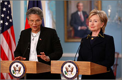 Secretary of State Hillary Clinton, right, is preparing to travel to impoverished Haiti. Here, Clinton is seen at the State Department in Washington with Haitian Prime Minister Michele Duvivier Pierre-Louis on Wednesday. The people of Haiti say they would like Clinton to stop deporting Haitian refugees.