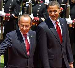 Mexican President Felipe Calderon and President Obama review the Guard of Honour at the presidential residence in Mexico City.