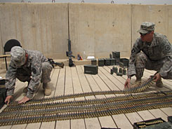 Staff Sgt. Alfred Luna, right, and Spec. Randy Neff count ammunition that 4th Engineer Battalion has to turn in before it departs Baghdad. The unit is getting ready to redeploy to Afghanistan, after arriving in Iraq just a few weeks ago.