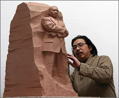 Sculptor Lei Yixin looks at a scale model of  a sculpture that he has created that will serve as the centerpiece of the memorial to the late Dr. Martin Luther King Jr. that will stand in the National Mall.