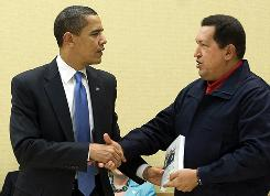 Venezuelan President Hugo Chavez gives a book to President Obama on Saturday at the Summit of the Americas in Port of Spain, Trinidad.