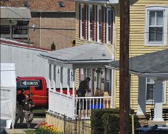 A sheriff's deputy prepares to enter a house in Middletown, Md., where five bodies were found on Saturday.