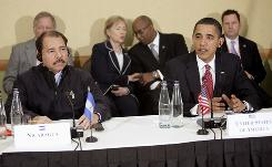 Nicaragua's President Daniel Ortega, left, looks on as President Obama makes a statement during a multilateral meeting with Central American leaders in Port-of-Spain, Trinidad and Tobago on Sunday.