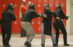 Richland County school resource officers carry out instructions Friday in Columbia, S.C., with the Texas State University-San Marcos active-shooter program that has trained 20,000 officers since 2002.