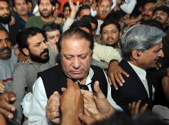 Former Pakistani premier Nawaz Sharif -- seen here at a March 16 rally in the central city of Gujranwala -- is in a strong political position once again after winning a confrontation over the independence of Pakistan's courts.